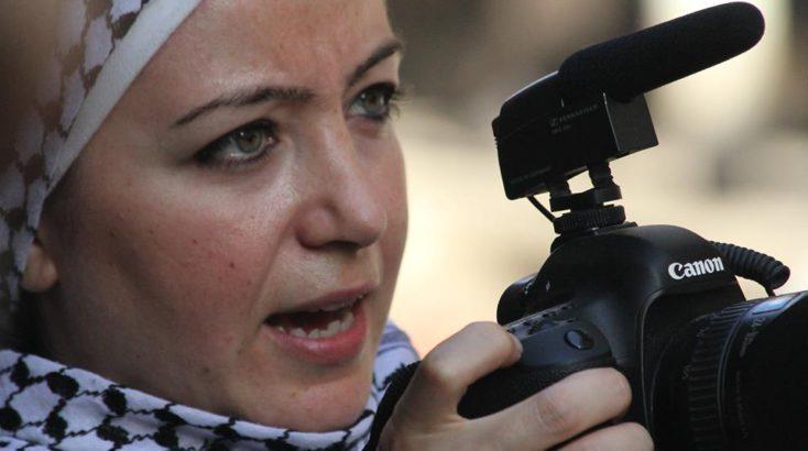 Zaina Erhaim with camera - Humanity House